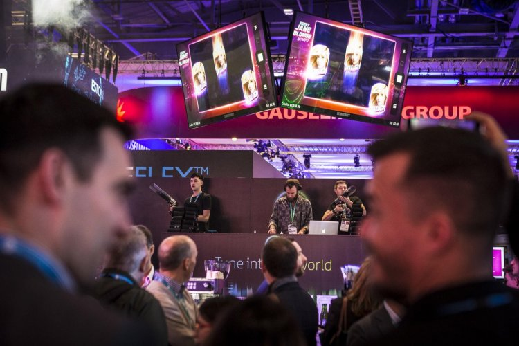 Microgaming draw crowds to their stand at ICE London with T-shirt cannons and 1000 T-shirts to give away